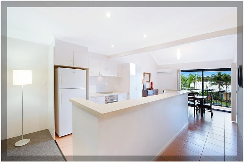 Open plan kitchen and living area.  Photo Courtesy of Prime Property GC.